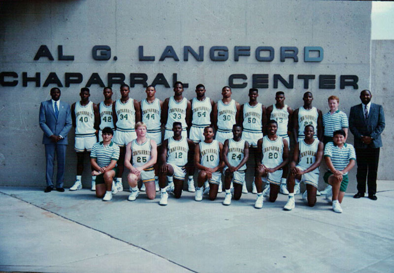 Men's basketball team standing in front of Chap Center