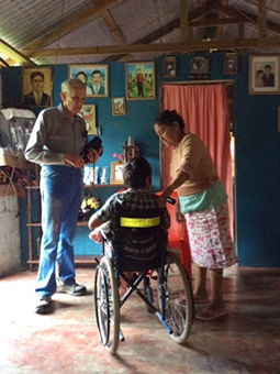 Midland doctor using Spanish while treating Belize villager