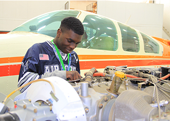 MC Student working on airplane engine