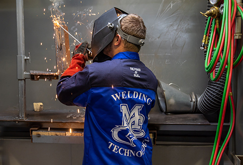 Students learning/practicing in MC welding shop