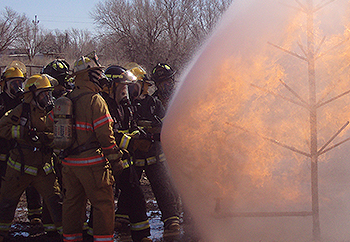 Fire Science students practicing a drill at the training fire field