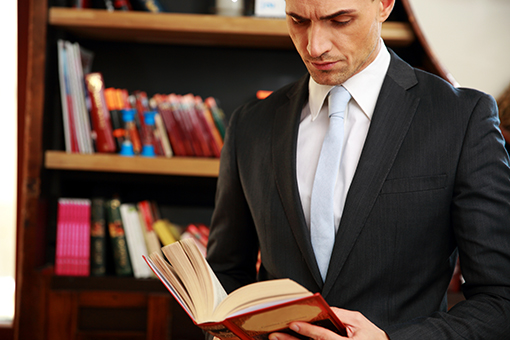 Paralegal reading a book in a library