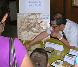 Geology instructor in community outreach at museum science night
