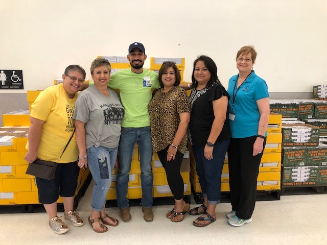 sAHEC employees and Communities in Schools personnel with school supplies