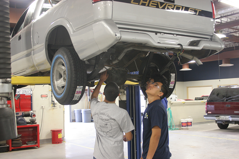 sAuto Technology students learning about car.