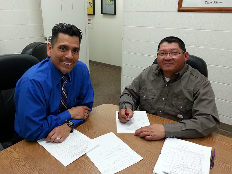sAlfredo Chaparro, director of the Midland College BEDC, assists a client with a small business loan application.