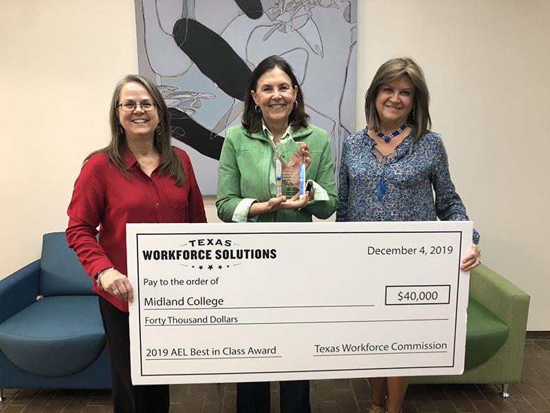 sValerie Hall, Lynda Webb and Luisa Nail with award from Texas Workforce Commission